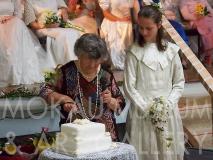 PA128770 : Mavis Petersen cutting cake, her great grand-daughter Emma standing beside her