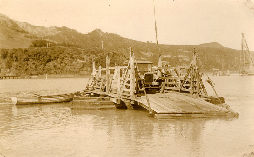 A car on the ferry in 1925. The beginning of the bridge piles can be seen on the right.