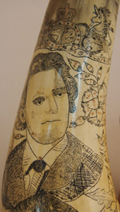 Dennis Gunn's lawyer depicted on scrimshaw bullock horns